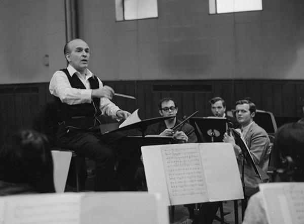 man conducting orchestra rehearsal